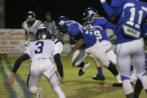 FOOTBALL: Devils down Trojans