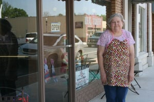 <p>Ideal Bakery owner Debbie Brown stands in front of her Cedartown store. She said the store will be closing on Saturday, April 26 after decades in business on Main Street. </p>