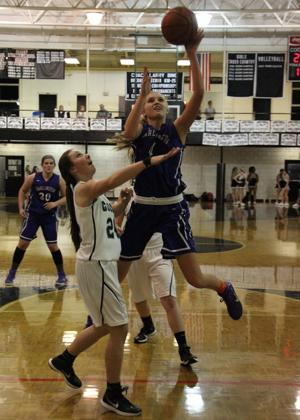 BASKETBALL: Lady Tigers' defense shines in win