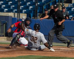 <p>Rome catcher Jonathan Morales (left) applies the tag to Charleston's Jhalan Jackson as he slides into home in the second inning of a game Saturday, June 25, 2016, at State Mutual Stadium. (Photo by Steven Eckhoff)</p>