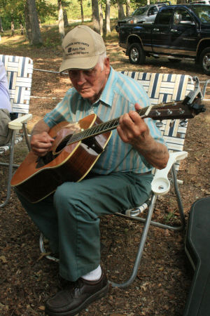 <p>Rembert Shope, 82, of Calhoun, plays his Martin guitar during the Armuchee Bluegrass Festival on Friday night, Aug. 29, 2014. Shope said he's been playing guitar for the past 72 years. (Carolyn Grindrod, RN-T)</p>