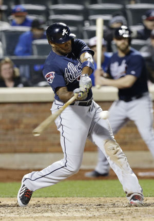 <p>Atlanta Braves' Justin Upton hits a three-run home run during the ninth inning of a baseball game against the New York Mets, Saturday, April 19, 2014, in New York. (AP Photo/Frank Franklin II)</p>