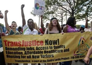 <p>FILE - In this June 27, 2014 file photo people march during the 10th annual Trans Day of Action in New York. Participants decried violence and discrimination while celebrating strides made by the lesbian, gay, bisexual and transgender communities. According to demographer Gary Gates of the UCLA School of Law's Williams Institute, an estimated 3.4 percent of American adults identify as lesbian, gay or bisexual, while only one-tenth that many — about 700,000 — are transgender. (AP Photo/Frank Franklin II, File)</p>