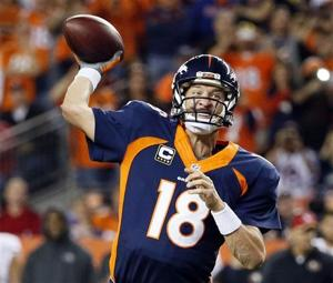 <p>Denver Broncos quarterback Peyton Manning throws his 509th career touchdown pass to set the all time record during the first half of an NFL football game against the San Francisco 49ers, Sunday, Oct. 19, 2014, in Denver. Manning has broken Brett Favre's record for touchdown passes with his 509th. (AP Photo/Jack Dempsey)</p>