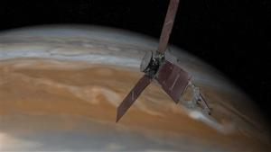 """<p><span id=""""_oneup"""" style=""""font-size: 12px;"""">This artist's rendering provided by NASA and JPL-Caltech shows the Juno spacecraft above the planet Jupiter. Five years after its launch from Earth, Juno is scheduled to go into orbit around the gas giant on Monday, July 4, 2016. (NASA/JPL-Caltech via AP)</span></p>"""