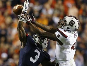 <p>Auburn defender Jonathan Jones (3) breaks up a pass intended for South Carolina wide receiver Shaq Roland (4) during the second half of an NCAA college football game on Saturday, Oct. 25, 2014, in Auburn, Ala. Auburn won 42-35. (AP Photo/Butch Dill)</p>