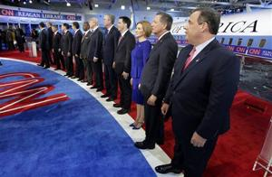 <p>Republican presidential candidates, from left, former Pennsylvania Sen. Rick Santorum, former New York Gov. George Pataki, Sen. Rand Paul, R-Ky., former Arkansas Gov. Mike Huckabee, Sen. Marco Rubio, R-Fla., Sen. Ted Cruz, R-Texas, retired neurosurgeon Ben Carson, businessman Donald Trump, former Florida Gov. Jeb Bush, Wisconsin Gov. Scott Walker, businesswoman Carly Fiorina, Ohio Gov. John Kasich, and New Jersey Gov. Chris Christie take the stage during the CNN Republican presidential debate at the Ronald Reagan Presidential Library and Museum on Wednesday, Sept. 16, 2015, in Simi Valley, Calif. (AP Photo/Chris Carlson)</p>