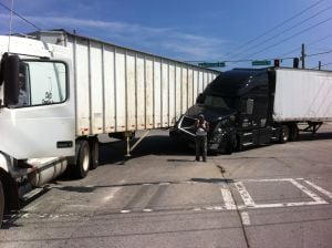 2 tractor trailer trucks collide near intersection of Redmond Circle and Garden Lakes Boulevard