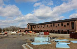 <p>The back side of Anna K. Davie features a bus drop off/pick up area and another driveway. Progress continues on Tuesday, Jan. 27, 2015. (Sierra Campbell/Rome News-Tribune)</p>