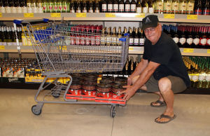 <p>Bill Harp, Rome, loads his buggy with Beaumont coffee, an Aldi product he said he's driven as far away as Arkansas to get in the past. Rome's new Aldi, 836 Turner McCall Blvd. formally opened Thursday morning. (Doug Walker, RN-T)</p>
