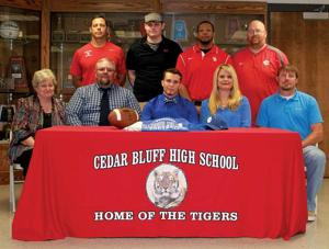 <p>Cedar Bluff senior defensive back Blake Terry signed a football scholarship with Illinois College on Thursday. Pictured sitting from left is Carolyn Terry, Brent Terry, Blake Terry, Heather Money, and Jackie Money. Standing from left is Cedar Bluff head football coach Jonathan McWhorter, Austin Terry, and Cedar Bluff assistant coaches Torey McDaniel and Scott Clifton. Photo by Shannon Fagan.</p>