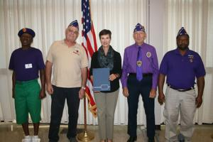 <p>Cedartown Commission chair Dale Tuck presents members from the Military Order of the Purple Heart with a proclamation on Sept. 8.</p>