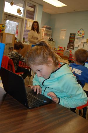 <p>Aubri Dostart, a second-grader at Glenwood Primary, works on her Chromebook in April Cummings' class. (Photo Contributed by Floyd County Schools)</p>
