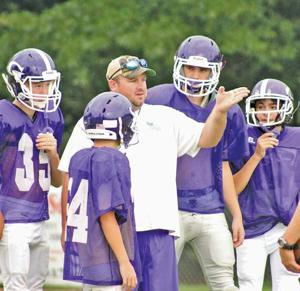 """<p>Gaylesville football coach Kyle Garmon instructs his players at practice last season. Garmon was recently selected as one of seven honorees for the AHSAA and AHSADCA's """"Making a Difference"""" award. Photo by Shannon Fagan.</p>"""