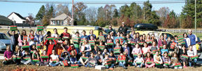 <p>Ringgold Elementary students and staff representatives celebrate a job well done with school partner and project donor, Heather Burroughs from Ringgold United Methodist Church, and J103's Ted Gocke and Clark Thompson.</p>