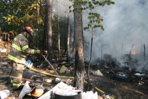 Neighbor alerts sleeper to morning fire in Lindale; shed with paint, propane destroyed
