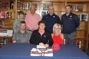 <p>Tim Rogers and Mitzi Bailey were among those on hand at Gordon Lee High School on Wednesday as their son, Chaney Rogers, signed on to continue his baseball career at the University of Georgia. Also attending the ceremony were grandparents Dennis and Peggy Lemming, Gordon Lee assistant baseball coach Derek McDaniel and Gordon Lee head baseball coach Mike Dunfee. (Messenger photo/Scott Herpst)</p>