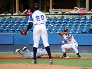<p>Rome first baseman Carlos Castro (right) watches the throw from pitcher Touki Toussaint (20) as Charleston's Jeff Hendrix (6) slides back to the bag during the second inning of a game Friday, June 24, 2016, at State Mutual Stadium. (Jeremy Stewart/RN-T.com)</p>