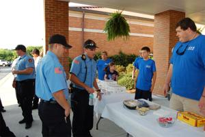 <p>Rome-Floyd County firefighters (from left) Jon Miller and Chris Cox are treated to breakfast by members of Oak Hill Church of Christ and Youth Minister Andrew Shelton. (Contributed photo)</p>