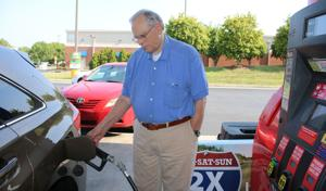 <p>Pat Parrino fills his vehicle's tank at Kroger's gas station Thursday, July 21, 2016. (Kristina Wilder / RN-T.com)</p>