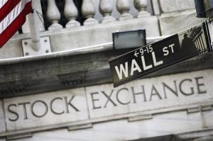 <p>FILE - This July 16, 2013 file photo shows a Wall Street street sign outside the New York Stock Exchange in New York.  (AP Photo/Mark Lennihan, File)</p>