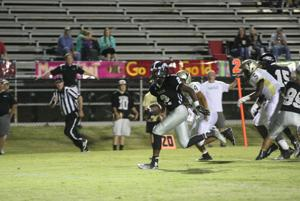 FOOTBALL: Back in black: Ware paces Eagles toward region championship
