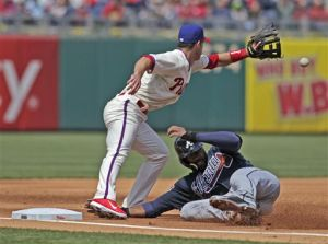 <p>Atlanta Braves' Jason Heyward slides safe into third as Philadelphia Phillies' Jayson Nix waits for the ball in the third inning of a baseball game Thursday, April 17, 2014, in Philadelphia. (AP Photo/H. Rumph Jr)</p>