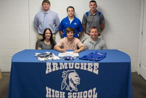 <p>Armuchee's Easton Mathis (seated, center) recently signed to wrestle for Willams Baptist College in Walnut Ridge, Arkansas. Joining him at the signing are his mother Mandy Mathis (seated, from left), his father Josh Mathis, Chris Butler (standing, from left), Nolan Smith and Armuchee head coach Joey Harris. (photo by Lindsey LaRue)</p>