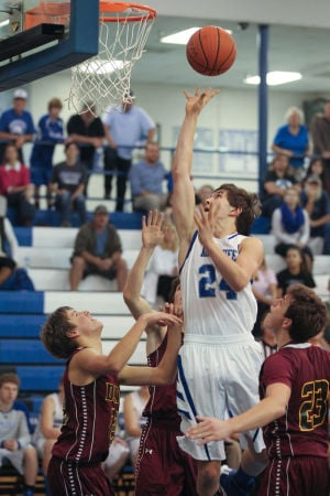 BOYS BASKETBALL: Indians rally past Wolverines