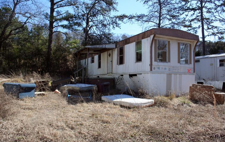 Crews Razing Mobile Home Park On US 411 South