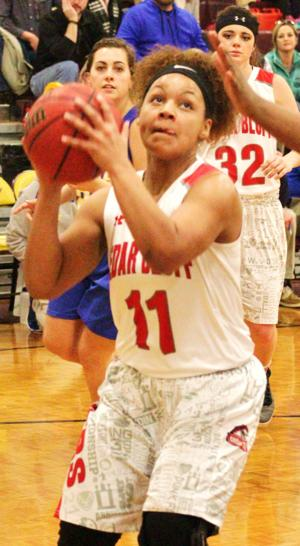 <p>Cedar Bluff's Kiana Dobbins drives in for a basket against Coosa Christian during the Class 1A, Area 13 tournament on Wednesday. Photo by Shannon Fagan.</p>