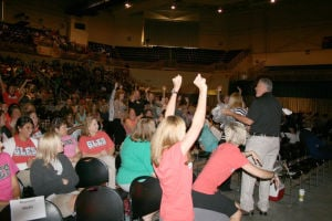 <p>Central office personnel distribute door prizes to the crowd during the Destination Graduation event at The Forum. Floyd County Schools staff gathered Tuesday at The Forum to hear Ron Clark speak. (Kristina Wilder / RN-T.com)</p>