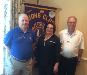 <p>From left: Installing officer Lions Past District Gov. Scott Warren of Woodstock, President Donna Parker and past President Thurmon Morris. (contributed photo)</p>
