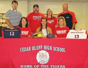 <p>Cedar Bluff softball catcher Destinie Grace signed with Southwest Tennessee Community College on Friday. Sitting from left is Cedar Bluff softball coach Mandy Walker, Destinie Grace and Cedar Bluff assistant softball coach Kelsey Hilliard. Standing from left is Joey Foster (Grace's hitting coach), Rodney Crane (father), Tammy Crane (mother) and Southwest Tennessee softball coach Keith Gentry. Photo by Shannon Fagan.</p>
