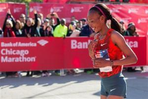 <p>FILE - In this Sunday, Oct. 12, 2014 file photo, Rita Jeptoo of Kenya reacts after crossing the finish line to win the women's race during the Chicago Marathon, in Chicago, Illinois. The agent for Chicago Marathon champion Rita Jeptoo said Friday, Oct. 31, 2014 that the Kenyan runner has failed a doping test. (AP Photo/Andrew A. Nelles, File)</p>