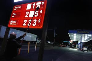 <p>FILE - In this Tuesday, Nov. 1, 2016, file photo, Leon Balagula changes the price for the gasoline at his Sunoco station in the early morning, in Fort Lee, N.J. OPEC's decision on Wednesday, Nov. 30, 2016, to cut production gave an immediate boost to oil prices, but the impact on consumers is likely to be more modest and gradual. (AP Photo/Seth Wenig, File)</p>