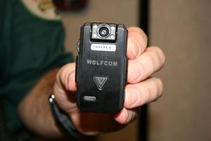 <p>Chief Deputy Tom Caldwell holds a Wolfcom Vision 1080p A/V recorder. Floyd County Sheriff's deputies working in the warrant division will start wearing the cameras in mid-November, according to Caldwell. (Carolyn Grindrod, RN-T)</p>