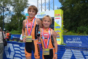 <p>Sam Tullis (left) competed in the 11-year-old division, and William Tullis raced in the 8-year-old division. Both took home first place in the Hy-Vee Kids Triathlon. (Contributed photo)</p>