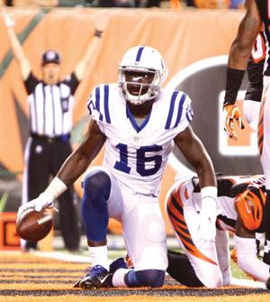 <p>Indianapolis receiver Da'Rick Rogers gets up after catching a touchdown pass in the Colts' preseason finale against Cincinnati. (Frank Victores, The Associated Press)</p>