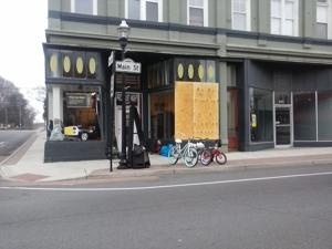 <p>A board covered up a broken storefront window at Priced Just Right on Main Street in Cedartown, one of several stores to have been struck by vandalism on Wednesday evening. </p>