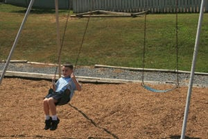 <p>There was no waiting Thursday for the swings at St. Mary's Catholic School for Eli Johnson, 4. (Alan Riquelmy/RN-T.com)</p>