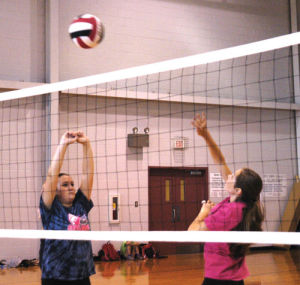 <p>Sonoraville High volleyball player Gracen Hornbrook (left) sets up camper Alea Johnson for a spike on Wednesday. (Alex Farrer, CalhounTimes.com)</p>