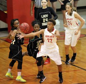 PREP BASKETBALL: Lady Wolves down Lady Dragons, 69-65