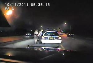 <p>In this image made from an Oct. 11, 2011 video made available by the Florida Department of Highway Safety and Motor Vehicles, Florida Highway Patrol Officer Donna Watts arrests Miami Police Department Officer Fausto Lopez who was traveling at 120 miles per hour to an off-duty job, in Hollywood, Fla. After the incident, Watts says that she was harassed with prank calls, threatening posts on law enforcement message boards and unfamiliar cars that idled near her home. In lawsuits, she accused dozens of officers of obtaining information about her in the state's driver database. (Florida Department of Highway Safety and Motor Vehicles via AP)</p>