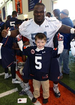 Auburn football Jeff Whitaker and pediatric cancer patient
