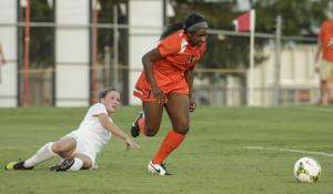 Courtney Dike outruns Florida State's Isabella Schmid.