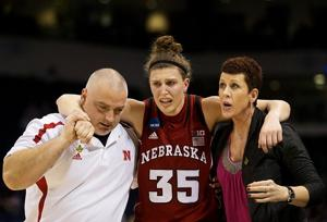 Notes: NU's Hooper reinjured left ankle