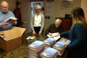 Signing books is no tap dance: It's a race to the finish