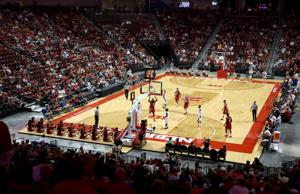 Huskers draw big crowd for scrimmage, and get a close call