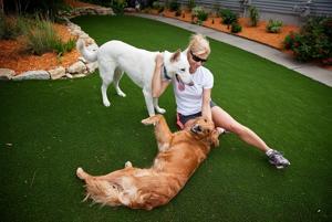 Sick of dead yard, Bluffs woman installs $30,000 synthetic lawn